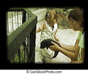 girl play with piggy - mother and daughter play with small...