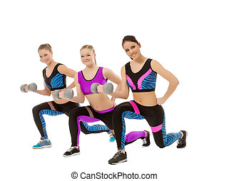Training with dumbbells. Shot of cute girls posing