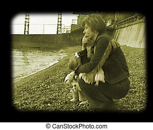 scene at the autumnal sea beach - mother and daughter at the...