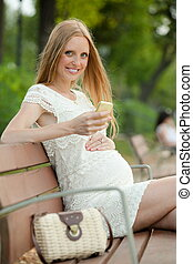 Pregnant woman using mobile phone