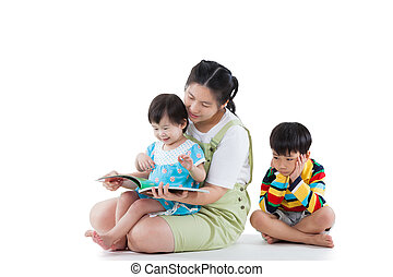 Mother with her child, daughter reading a book, son feel bad...