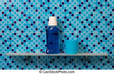 Mouthwash on bath shelf on blue background
