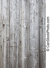 part of fence with grey weathered planks - vertical part of...