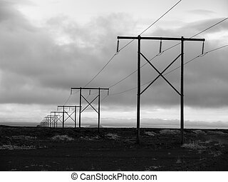 Icelnadic landscape with typical power lines, black and...