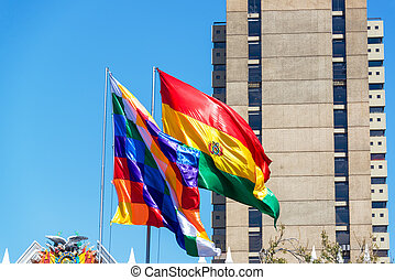 Bolivian Flags - Two Bolivian flags blowing in the wind. The...