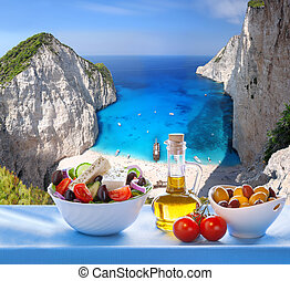 Navagio beach with Greek salad in Zakynthos, Greece - Famous...