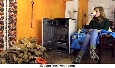 "woman close old stove - ""young blond woman with woolen warm..."