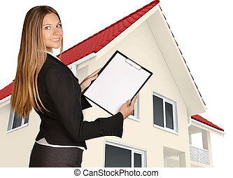 Woman standing sideways and holding a clipboard.