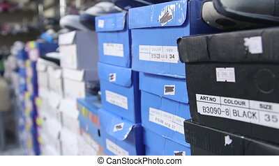 Dolly: Row of shoes boxes stacked in the children shoe store