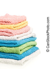 Towels - Stack of folded towels on white background