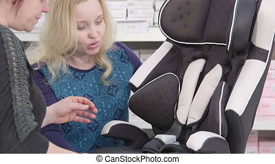 Buying a baby car seat close-up