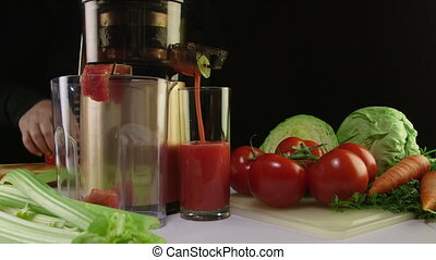 Tomato juice extracted using an electric cold press juicer