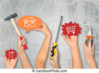 Peoples hands holding tools on grey background