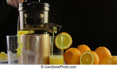 Dolly: Making fresh fruit juice from orange using electric...