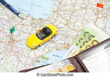 wallet, pen and sport car on map of Europe