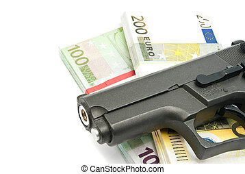 gun and banknotes on white - gun and banknotes closeup on...
