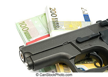 gun and banknotes on white background closeup