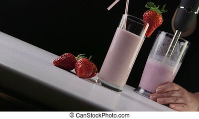 Dolly: Making fresh milk and strawberry smoothie drink using stick hand blender
