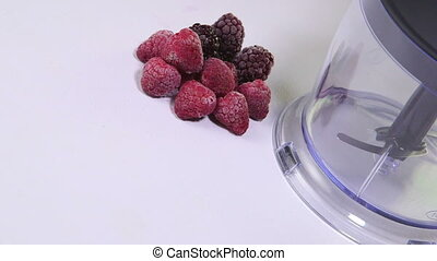 Dolly: Grinding frozen berries using stick hand blender -...