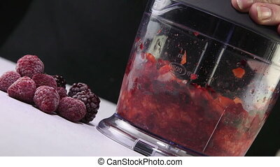 Grinding frozen berries using stick hand blender - Grinding...