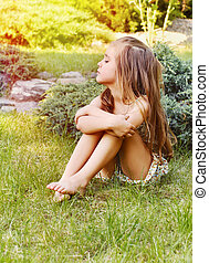 young little naughty girl outdoor in the park - young little...