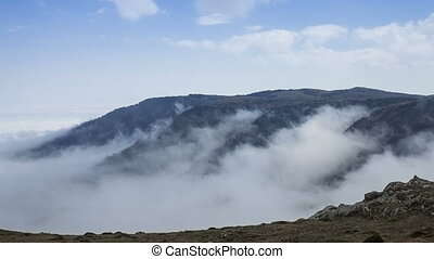 Fog moving on the mountain slopes - The fog is moving on the...