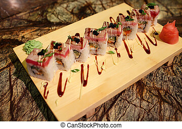 Delicious Sato maki sushi rolls served with a wood plate