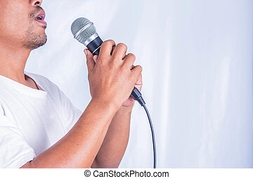 Young man singing - Young man holding a microphone and...