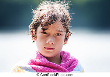 colse up of brown eyed boy - closeup of a brown eyed boy at...