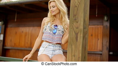 Relaxed blond woman wearing casual summer outfit - Relaxed...