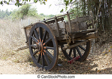 Old wooden Indian wagon for transportation.