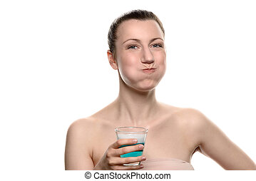 Woman using mouthwash during oral hygiene routine - Healthy...