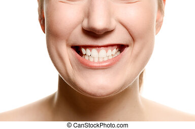 Smiling woman showing her teeth - Close up of the mouth of a...