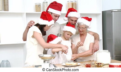 Happy family baking Christmas cakes
