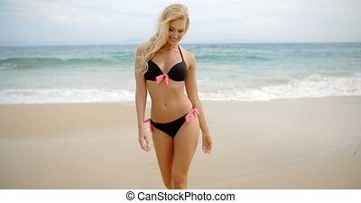 Blond Woman in Bikini Walking To Camera on Beach - Front...