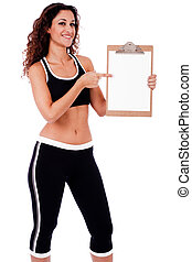 Fitness woman showing a blank clip board