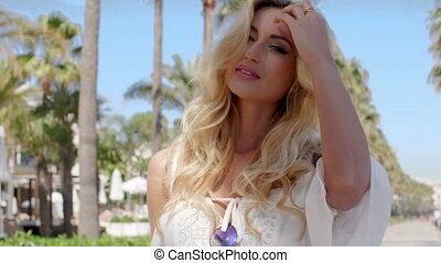 Blond Woman with Hand in Hair Outdoors - Sexy Blond Woman...