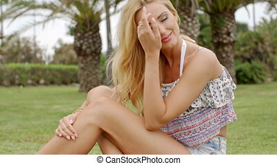 Blond Woman in Summer Clothes Sitting on Grass - Sexy Blond...