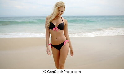 Blond Woman in Bikini Walking To Camera on Beach