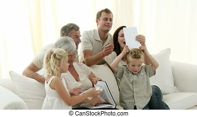Happy family observing photographs