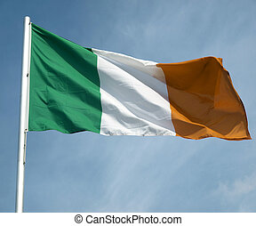 Irish flag over a blue sky background