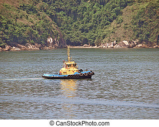 tug boat on the sea and mount backwards