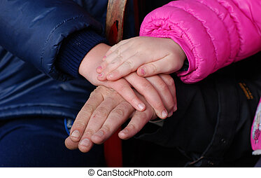 Family holding hands together