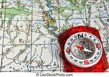 compass on the map. - The compass on the map. Photo magnetic...