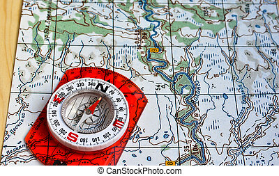 Map and compass. Photo magnetic compass located on a...