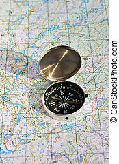 Geographical map and a compass Photo magnetic compass...