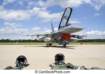 Military jet fighter - Modern F-16 jet fighter with pilot...