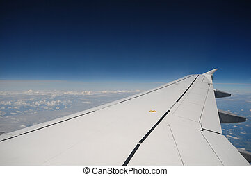 Flight - airplane wing during flight