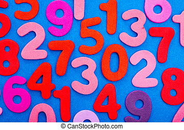 Variety of Numbers in red and pink on blue - A viariety of...
