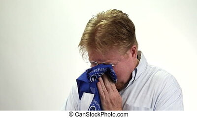 Man Blowing Nose Bandanna - Mature red headed man with...